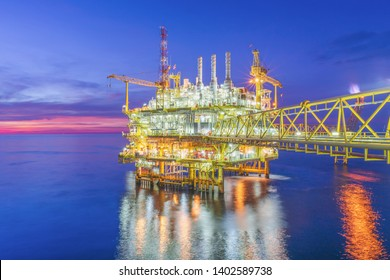 Offshore oil and Gas processing platform with the sunset cloud. oil and gas industry to treat raw gases and sent to onshore refinery, petrochemical and power generation plant.