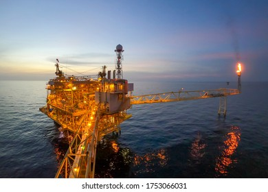 Offshore oil and gas or rig platform with beautiful sky in the evening time for oil and gas business concept.
