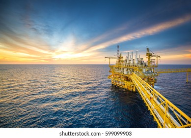 Offshore oil and gas rig platform with beautiful sky in the gulf of Thailand.