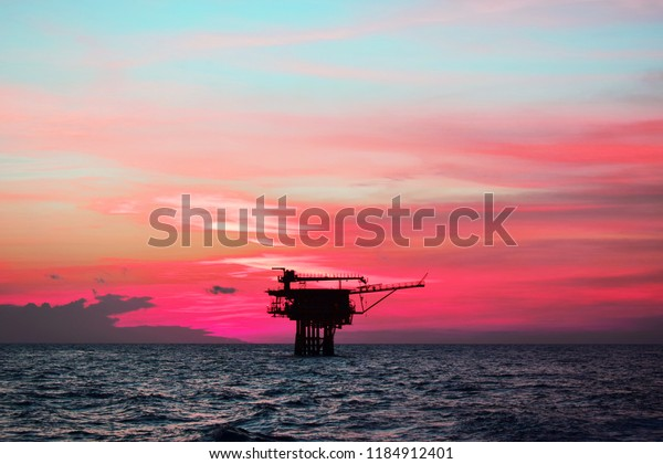 Offshore oil and gas rig platform with beautiful sky in the gulf of southeast asia