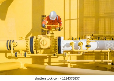 Offshore oil and gas site service operator open valve for control gases and crude product, Petroleum and chemical industry business.