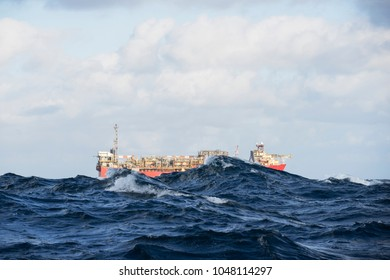 An offshore oil installation during rough sea