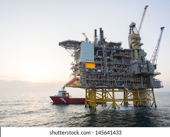 Offshore oil platform with a supply vessel on the North Sea, in the Norwegian sector