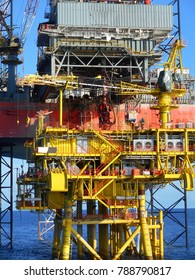 Offshore Oil Production platform close up detail view. Sit underneath rig floor with severe oil well slot