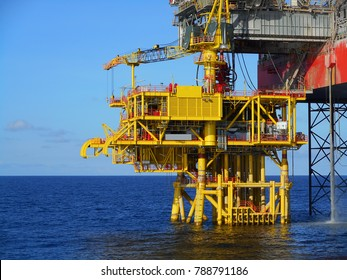 Offshore Oil Production platform close up detail side view. Sit underneath rig floor with severe oil well slot