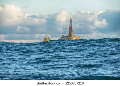 offshore oil rig covered with sea wave