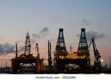 Offshore oil rig in dock after sunset