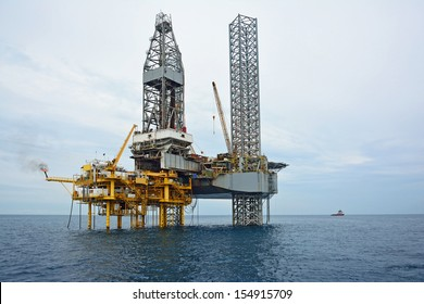 The offshore oil rig in early morning, Gulf of Thailand. industrial. energy. power oil and gas concept. Offshore oil and rig construction.
