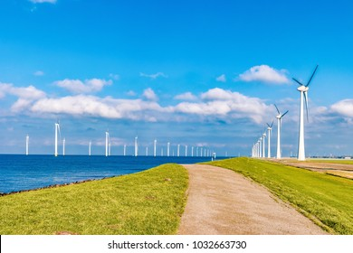 Offshore and Onshore Windmill farm in the ocean  Westermeerwind park , windmills isolated  on a beautiful bright day Netherlands Flevoland Noordoostpolder