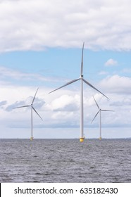 Offshore and Onshore Windmill farm Westermeerwind, Windmill park in the Netherlands with huge large wind turbines, group of windmills for renewable electric energy