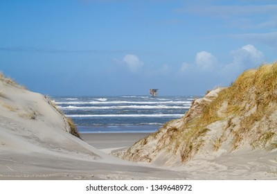 Offshore production platform near the Dutch island Ameland, beach and dunes in the foreground