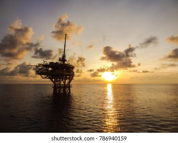 Offshore Remote Platform with sunset background, Oil and Gas