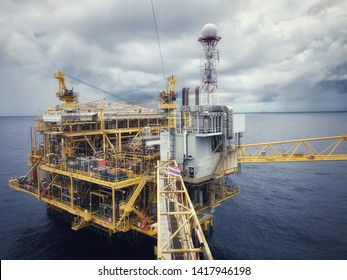 Offshore Rig Platform in the Middle of Gulf and Offshore oil and gas platform comprised of living quarter, central processing platform and well head platform with exhaust pipe and weather radar.