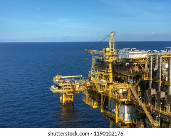 Offshore rig platform or Offshore oil and gas Accommodation Platform or Living Quarter and Production plant under calm sea and blue clear sky