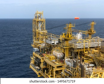 Offshore rig platform or Offshore oil and gas Accommodation Platform or Living Quarter and Production plant with a calm sea and blue sky
