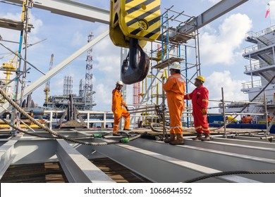 Offshore Terengganu, Malaysia. Circa August 2015. Offshore construction crews preparing the crane block for a heavy lifting of structure frame from a construction barge to ExxonMobil oil platform