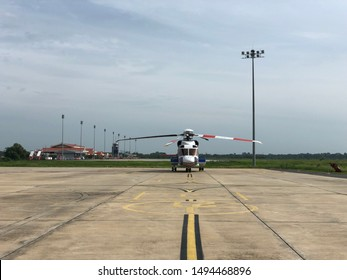 Offshore transport heavy helicopter on ramp sikorsky s92,Offshore Transport Helicopter and pilot or working offshore,The helicopter landed on the rig, sea, changing working group, working on the rig