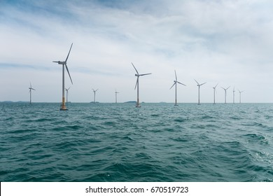 offshore wind farm with beautiful sea water , clean energy background