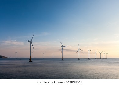 offshore wind farm at dusk, renewable energy background