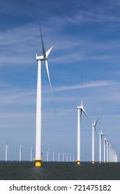 Offshore wind farm in front of blue sky with clouds in the IJsselmeer in the Netherlands, Noordoostpolder, Flevoland