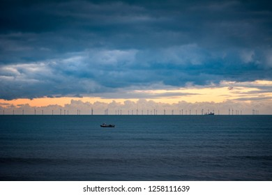 Offshore wind farm on horizon in the last light of day