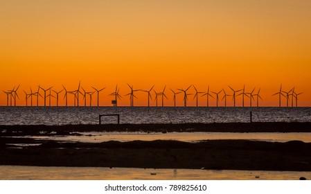 Offshore wind farm in Oresund between Sweden and Denmark when sunset
