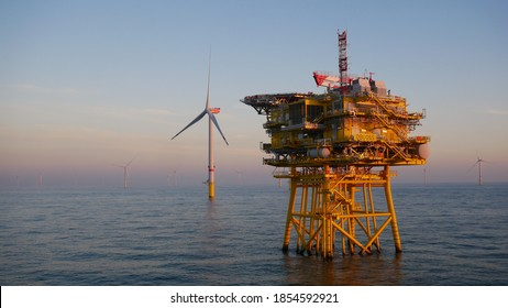 Offshore wind farm substation with turbine in North Sea - Shutterstock ID 1854592921