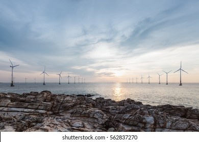 offshore wind farm in sunrise, renewable energy
