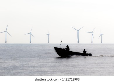 Offshore wind farm turbines. Border patrol security speed boat. Green energy demonstration at power plant location. Forces aided by coastguard patrolling the coast.