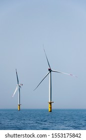 Offshore wind farm with two wind mills in the north sea.