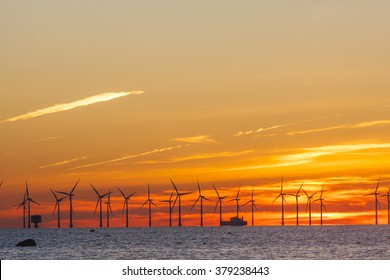 Offshore wind park in Oresund between Denmark and Sweden in sunset