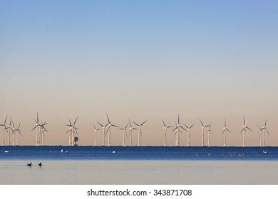 An offshore wind power station in Oresund between Denmark and Sweden when the first cold winter day in the end of November