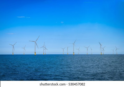 Offshore Wind Turbine in a Wind farm under construction off coast of England
