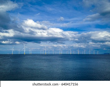 Offshore Wind Turbine in a Wind farm under construction off coast of England, UK
