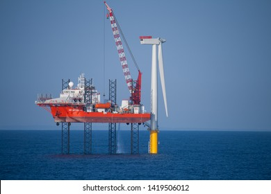 Offshore Wind Turbine in a Windfarm under construction  off the English Coast, North Sea