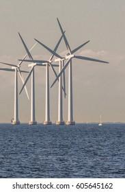 Offshore wind turbines in cloudy weather in Copenhagen, Denmark.