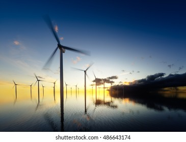 Offshore wind turbines at daybreak. 3d rendering.