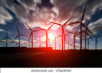 Offshore Wind Turbines Farm against a blurry sunset cloudy sky