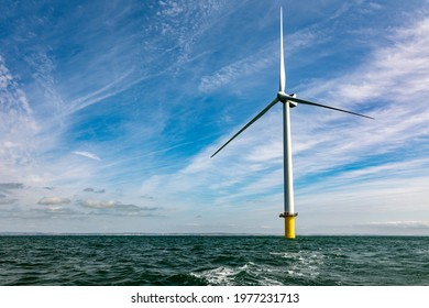 Offshore windfarm turbine and expanse of sea and sky
