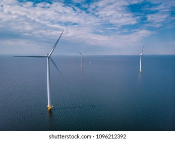 Offshore Windmill farm in the ocean  at the lake IJsselmeer by Urk Netherlands, isolated windmill park at sea, drone view from above out the sky