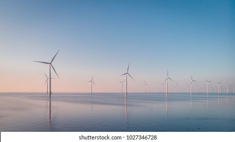 Offshore Windmill farm in the ocean  Westermeerwind park , windmills isolated at sea on a beautiful bright day Netherlands Flevoland Noordoostpolder birde eye view drone view