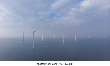 Offshore Windmill farm in the ocean  Westermeerwind park , windmills isolated at sea on a beautiful bright day Netherlands Flevoland Noordoostpolder