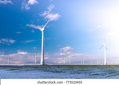 Offshore Windmill farm in the ocean  Westermeerwind park , windmills isolated at sea on a beautiful bright day Netherlands Flevoland Noordoostpolder white landscape with snow cold December weather