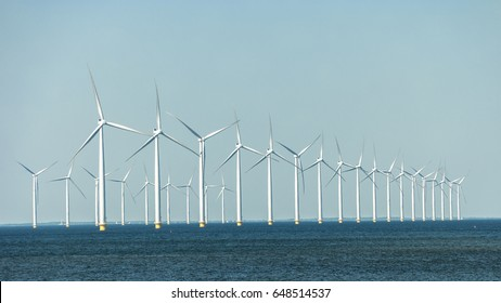 Offshore windmill park at sea, windmill generator turbines platform at sea, green energy from the ocean