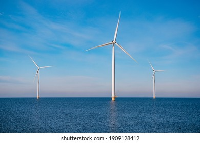 offshore windmill park with stormy clouds and a blue sky, windmill park in the ocean. Netherlands . Europe, windmill turbines in ocean with blue sky, green energy concept