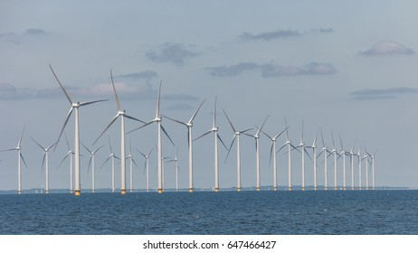 Offshore windmill park turbines at sea, Green energy windmill generators at sea ,Huge windmill farm ,Netherlands