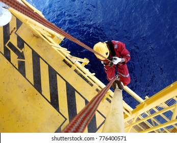 Offshore worker  using rope access of piping inspection.