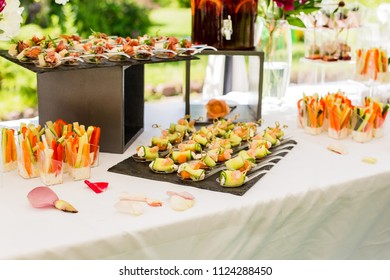 Offsite catering at the event. Serving the table with appetizers from meat, fish, vegetables and sauces.