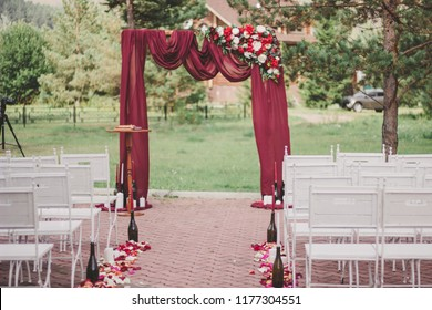 Offsite ceremony and arch of Marsala color
