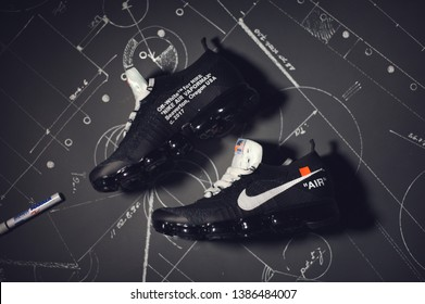 Off-White x Nike Air Vapormax sport shoes, sneakers, trainers flat lay shot on dark abstract background. Sport and casual footwear concept. Krasnoyarsk, Russia - December 26, 2017